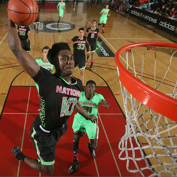 LONG BEACH, CA - AUG 4, 2014: Jaylen Brown #10 of 2015 adidas U.S. Howard goes up for the dunk during the 2014 adidas Nations consolation game against adidas Europe at Long Beach City College in Long Beach, California. (Photo by Kelly Kline/adidas)